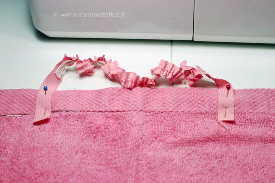 asciugamano-grembiulino