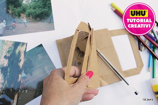 quadernino con busta di carta aperto con fogli