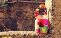 Tutorial-come-fare-lanterne-di-San-Martino-con-vasi-di-vetro-perline-in-legno-carta-velina-e-colla