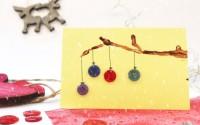 Come-fare-biglietto-di-Natale-dauguri-con-rametto-di-legno-e-bottoni