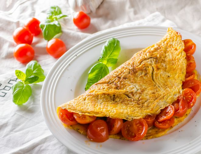 Rustic omelet with tomato, simple photo on white napkin